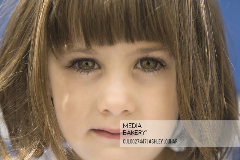 Close up portrait of young girls face