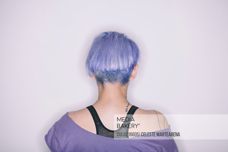 Rear view of woman with purple hair and t-shirt