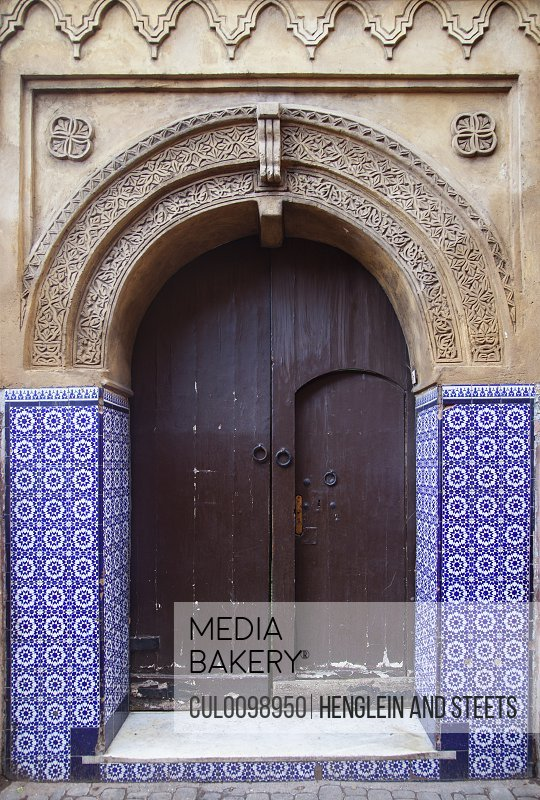 Ornate arched doorway with tiles