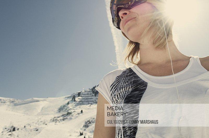 Woman in t-shirt admiring snowy hills