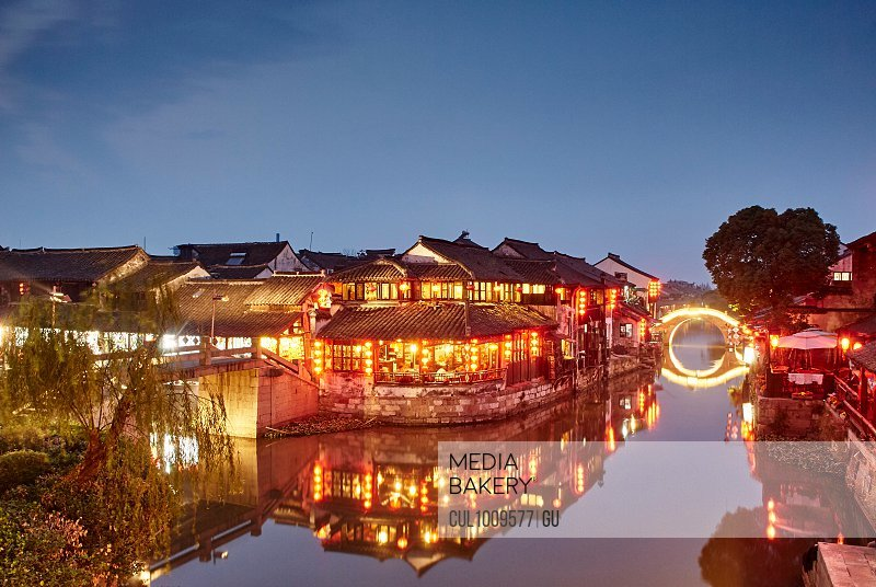 Waterway and traditional buildings at night, Xitang Zhen, Zhejiang, China