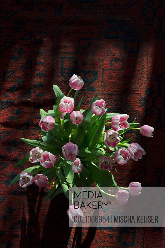 Tulip flower arrangement on carpet