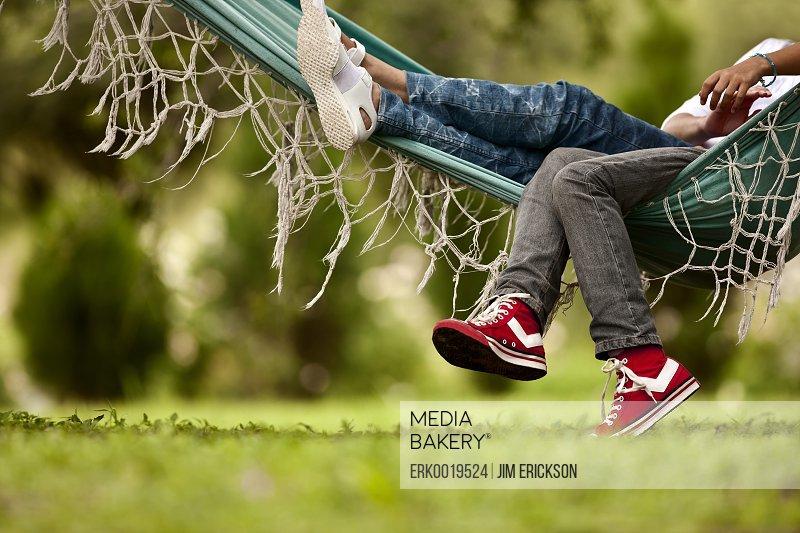 Two friends resting in hammock.