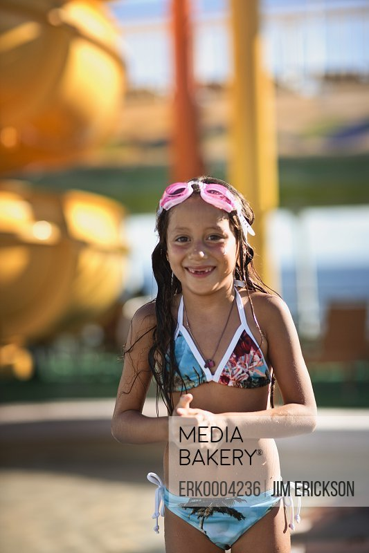 Portrait of young girl poolside.