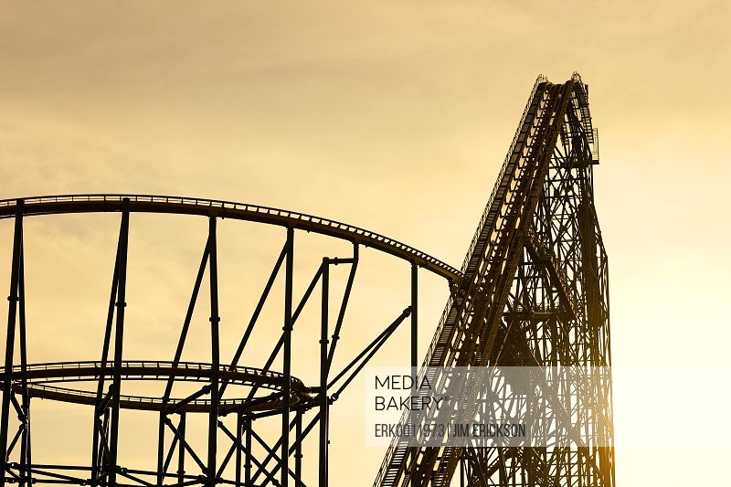 Silhouette of a rollercoaster at sunset.