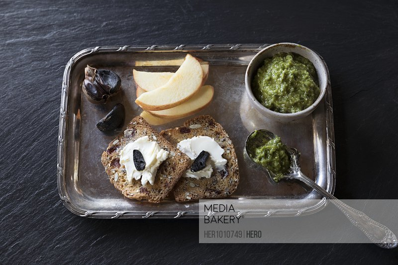 Still life nut bread with spreads and fruit on silver tray