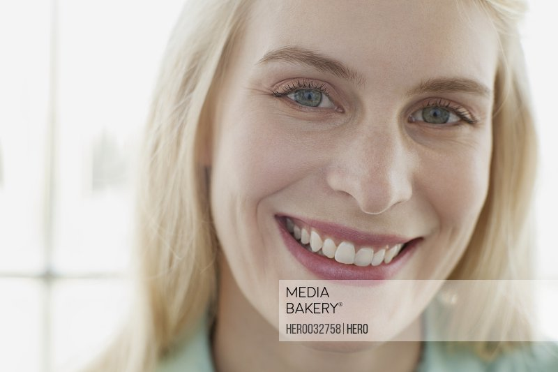 portrait of pretty blonde mid adult woman