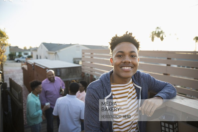 Portrait smiling African American young man on summer deck