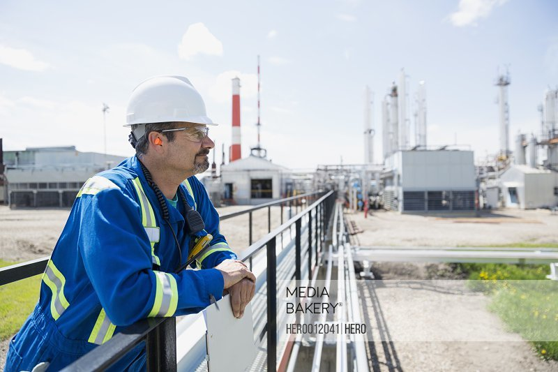 Male worker on platform outside gas plant