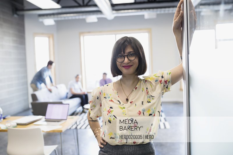 Portrait smiling businesswoman outside meeting