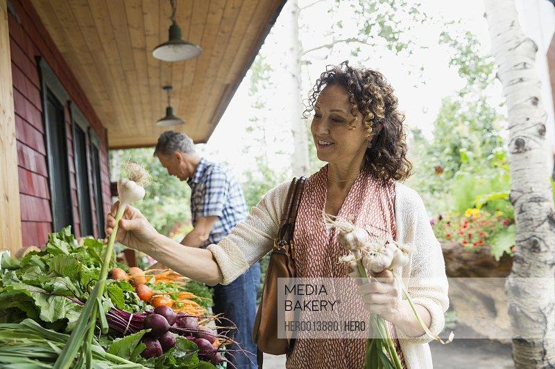 Woman shopping for garlic outside market
