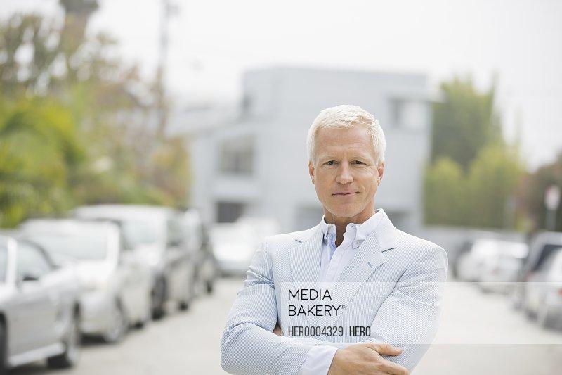 Portrait of confident man standing outdoors