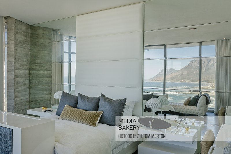 Luxury modern home showcase bedroom with ocean and mountain view