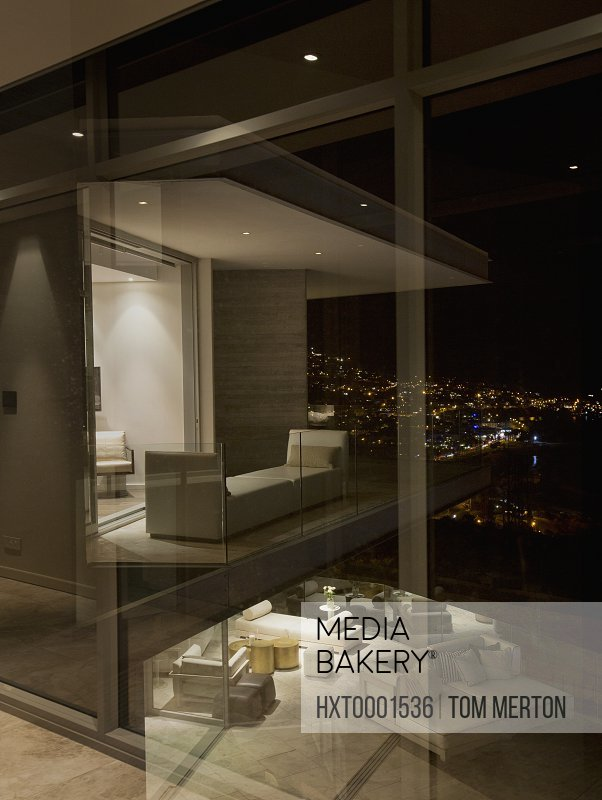 Illuminated luxury modern home showcase at night