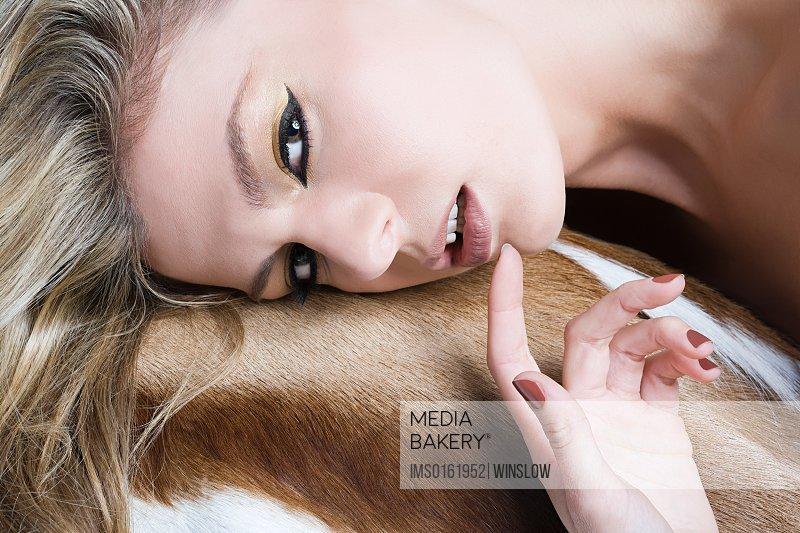 Woman leaning on animal skin