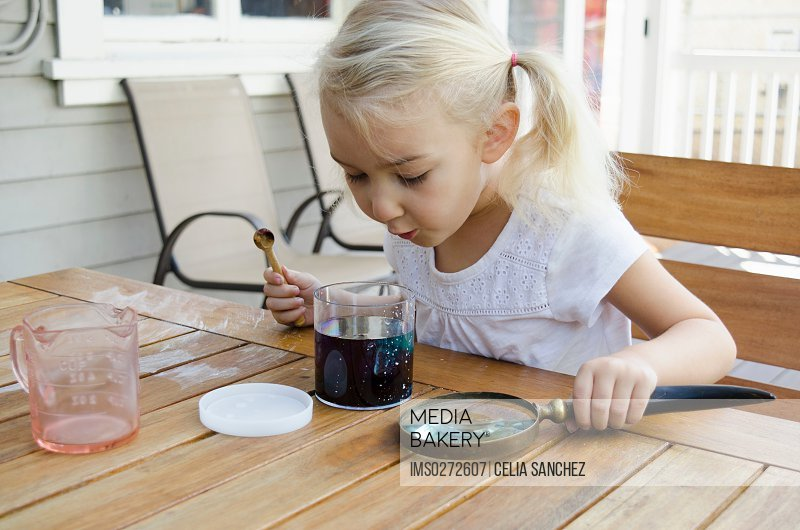 Young girl doing science experiment