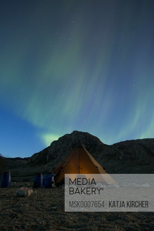Northern lights or Aurora Borealis over tent at night