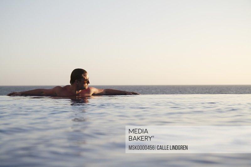 Man relaxing in water