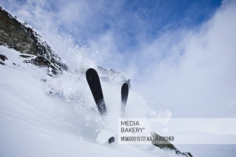 Skier crashing while skiing in the snow