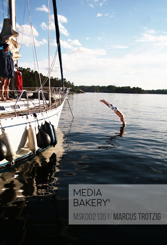 Person diving from sailing boat