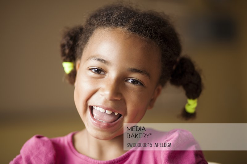 Close-up portrait of cheerful schoolgirl