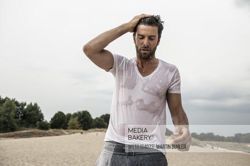 Portrait of man with wet t-shirt